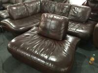 As new brown leather corner sofa and matching chair