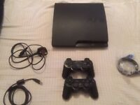 PS3 with multiple games and 2 wireless controllers