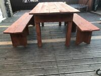 Garden table with to benches
