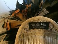 Nude Headpiece/ Fascinator/hat with black and orange feathers on the back