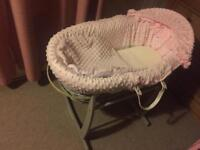 Pink Moses basket with rocking stand