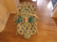 Baby bouncer with vibrations and music