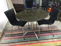 Circular granite table and 2 chairs