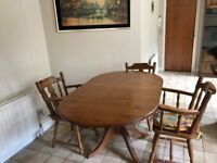Drop down pine table with three matching chairs