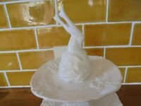 Beautiful white ceramic cake stand and charlie brown teapot