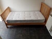 Oak single bed with good quality foam mattress.