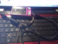 12 megapixel digital pink fujifilm camera, great photos, few marks on it, comes with charger and USB