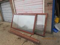 A pair of double glazed panels in a maghogany frame