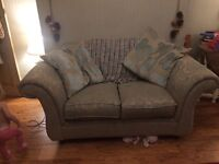 Vintage style green two seater sofa
