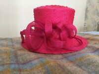 Fushia pink sinnamay hat, ideal for wedding or day at the races, add colour to an outfit