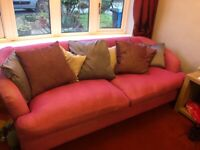 Pink sofa and cuddle chair