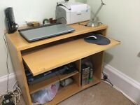 Computer desk with sliding shelves
