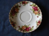 A Royal Albert saucer with Old Country Roses pattern, in very good condition