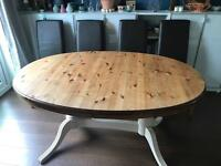 Solid pine extendable table and 6 faux leather chairs (2 not pictured)