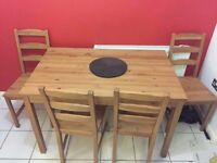 Pine dining table complete with 4 chairs