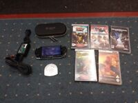 sony psp console with charger, 2 umd movies, 5 games, a case & a memory card with 80 games on it