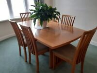 Danish Skovby oak veneer extending dining table with 6 high back chairs.