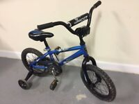 "Kids Norco Menace steel BMX style bike, 14"" wheels in blue"