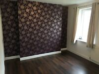 Unfurnished two bedroom ground floor property with garden.