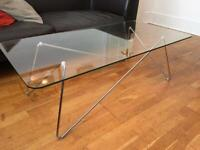 Unusual glass chrome coffee table with hairpin leg base.