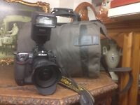 Nikon D2X with lens, flash and bag.