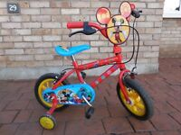 Mickey mouse small child bike with stabilisers approx age 2-5. Good first bike.
