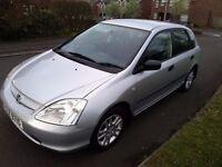 Late 03 honda civic mot,d driving perfect no faults.Good all round car. Easy taxed , insured.Cheap