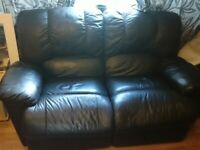 2 sofas good condition and an arm chair