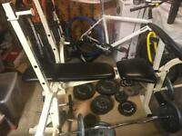 Weight bench with attachments for curls and leg extensions