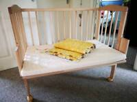 Next to bed baby cot
