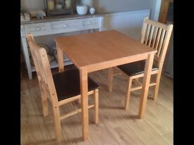 Table and two chairs. In excellent condition.