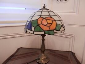 Small glass Tiffany style table lamp.