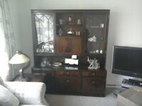 Large Dark wood Display Cabinet Glass Panel doors at top Three Drawer in Bottom area