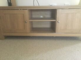 Lovely Oak effect tv unit with two sliding doors with storage also two shelves