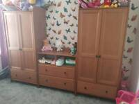 2 wardrobes chest of draw and a cot