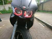 Gilera Runner st125 with red angel eyes