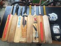 Collection of 8 well used short handle Cricket bats for sale, and two pairs of gloves.