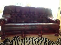 2 arm chairs and a 3 seater burgandy leather on a wooden frame. Hardly used and in good condition.
