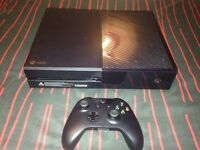 Xbox One with controller, ufc 2 , grand theft auto 5, fifa 16 and charger kit.