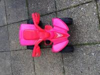 Pink electric ride on