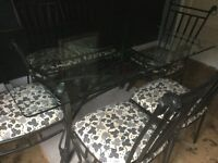 Glass & Black Wrought Iron Table and 6 Chairs