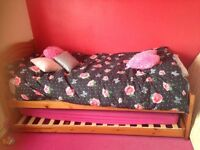 Single wooden bed with trundle without mattresses