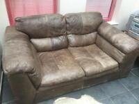 DFS Leon brown leather 2 seater sofa