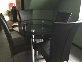 Glass Dining Table with 4 Faux Leather Chairs