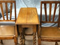 Drop leaf oak barley twist table and 2 chairs