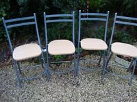 Four Steel Framed Folding Chairs.