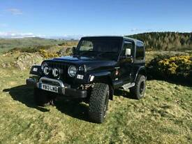 "2001 Jeep Wrangler Sahara. black. 4L manual. 3.5"" lift Off Road"