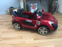 Red sports kids ride and go electric sports car
