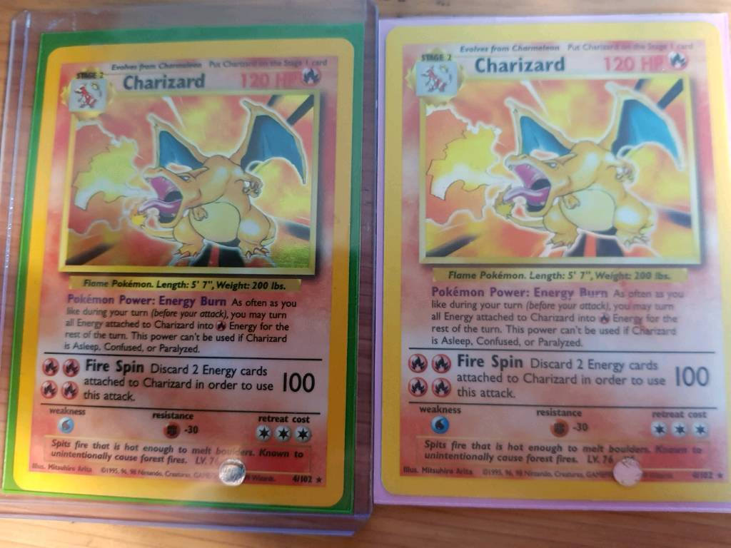 Base Set Charizards for sale or trade.