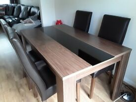 Dinning table + 4 chairsin new condition £250 also got matching tv unit in new condition £200